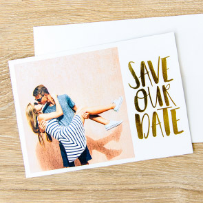 Couple kissing on Custom Save Our Date Foil Cards