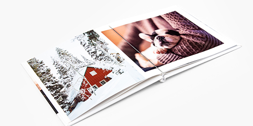 Snowy cabin and a sleeping dog in a Custom Photo Book Album
