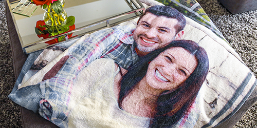 Smiling couple on a Custom Photo Blanket