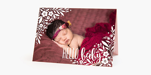 Baby under a red blanket sleeping on a red bed on a Classic Fold Card