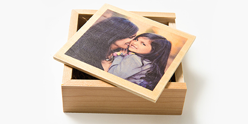 Mom holding daughter on the cover of a custom wooden USB box