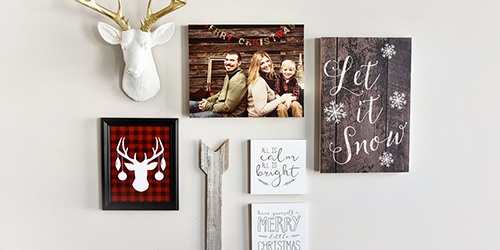 Family of three on a Custom Wall Decor hanging on the wall with other Christmas Decorations