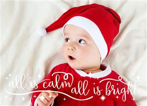 Baby in a Santa hat laying in bed on an All Is Calm Custom Christmas Card