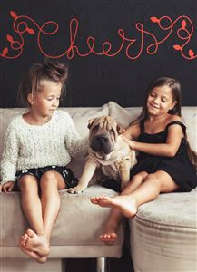 Two daughters with their dog on the couch on a Custom Christmas Card