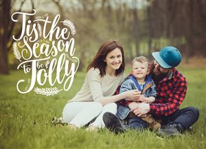 Mom and Dad pose with their baby boy on a Custom Christmas Card