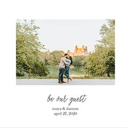 Couple kissing on the cover of their custom wedding invitations