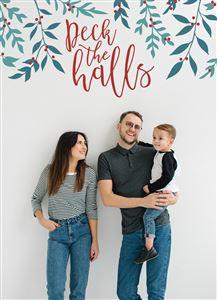 Mom and Dad pose with their son on a Custom Deck The Halls Christmas Card