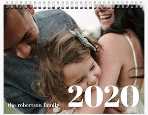 Mom and Dad with their young son on the cover of a Custom 12 Month Flip Calendar