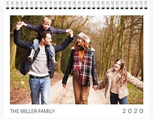 Family of four walking on a trail in the woods on a Custom 12 Month Flip Calendar