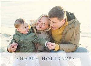 Family of three hanging out in the snow on a Custom Christmas Card