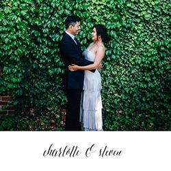 newlywed couple hugging infront of bushes on the cover of their custom wedding guest card