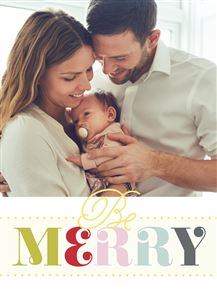 Mom and Dad hold their newborn baby on a Custom Christmas Card