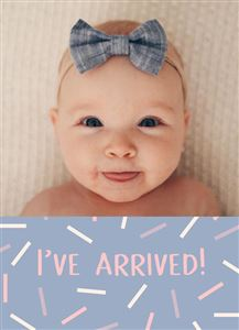 Smiling baby girl in bed on a Custom Confetti Themed Birth Announcement Card