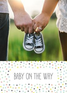 Couple holding baby shoes on a Baby Announcement Photo Card