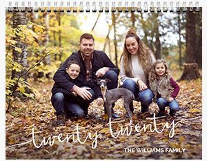 Family of four with their dog in the woods on a Custom 12 Month Flip Calendar