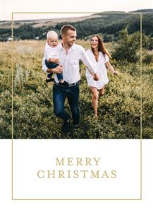 Mom and Dad with their baby boy walking up a hill on a Custom Christmas Card