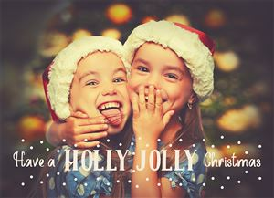 Two siblings in matching Santa hats smiling and laughing on a Custom Christmas Card