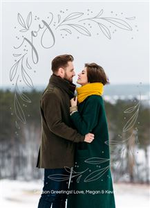 Couple posing for a picture in the snowy mountains on a Custom Christmas Card