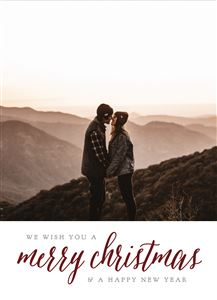 Couple kissing on top of a mountain on a Custom Christmas Card