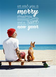 Dog and his owner sitting on a Longboard at the beach on a Custom Christmas Card