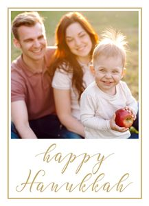 Mom and Dad with their newborn son who is holding an apple on a Custom Happy Hanukkah Card