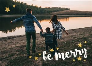Family of three holding hands next to a lake on a Custom Christmas Card