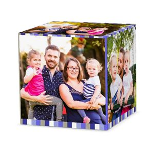 Mom and dad holding their two daughters on a custom icy striped cube