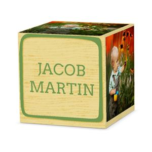 Baby playing with flowers on custom green letter block