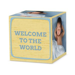 Sleeping newborn baby boy on custom light blue letter cube