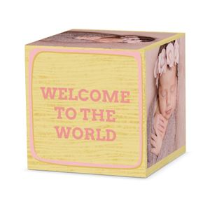 Sleeping newborn baby girl on custom light pink letter cube