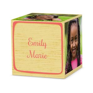 girl smiling on a custom pink letter block