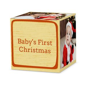Baby in Santa costume on a custom red letter cube