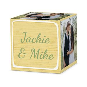 couple kissing on a custom white letter block