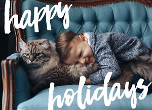 Baby snuggling with a pet cat on a Custom Holiday Card