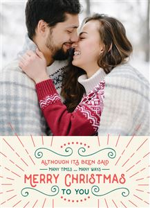 Couple kissing in the snowy woods on a Custom Christmas Card