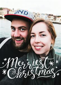 Couple smiling by the lake on a Merriest Christmas Card
