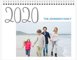 Couple kissing their baby on the beach on a Custom 12 Month Flip Calendar