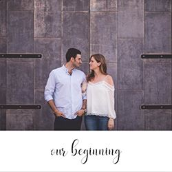 engaged couple locking arms for their custom wedding invitation cards