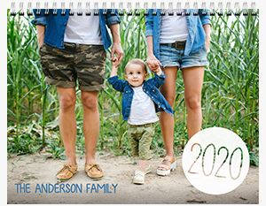 Mom and Dad holding their sons hand on the beach on a Custom Patterned 12 Month Flip Calendar