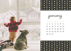Son looking out the window to the snow with his dog on a Custom Patterned Desk Calendar