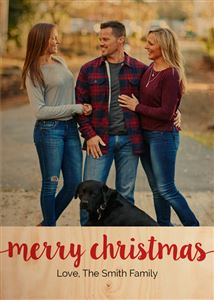 Family of three with their black lab smile for a picture on a Christmas Themed Wood Photo Card
