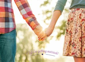 Couple holding hands on a Save The Date Wedding Invitation