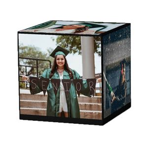graduating senior on a custom solid black cube