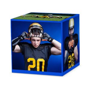 Football player with pads and helmet on a custom solid blue cube