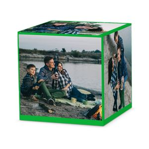 Family camping on a lake on a custom solid green cube