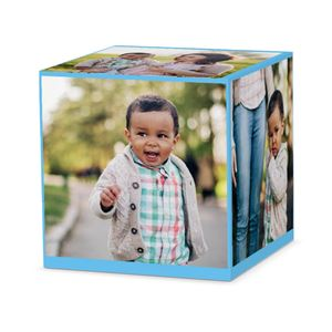 candid baby shots of him in a park on a custom light blue cube