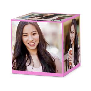 A girls senior pictures on a custom light pink cube