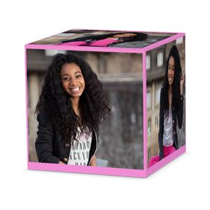 girl smiling in pictures on a custom pink cube