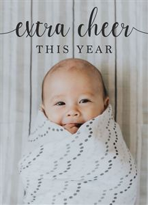 A smiling baby wrapped in a blanket on a Custom Birth Announcement Photo Card