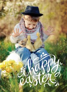Child in the grass with ducklings on his lap on a Custom Happy Easter Photo Card